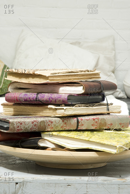 Still life with handmade journals stacked