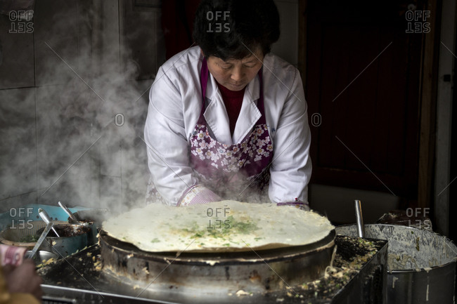 Shanghai, China - December 21, 2014: Woman making a burrito, Shanghai