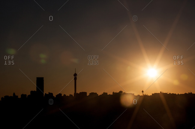 Sunset with lens flare behind the Johannesburg CBD