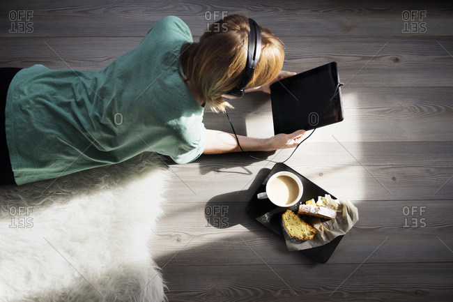 Woman with tablet by snacks