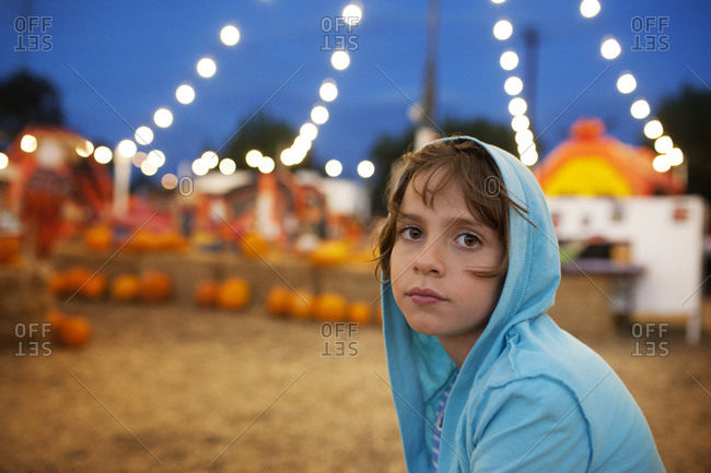 Girl under fall fest lights