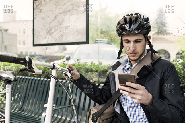 Cyclist in city with cell phone