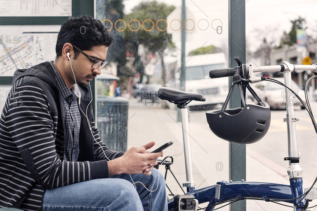 Man with phone by his bike