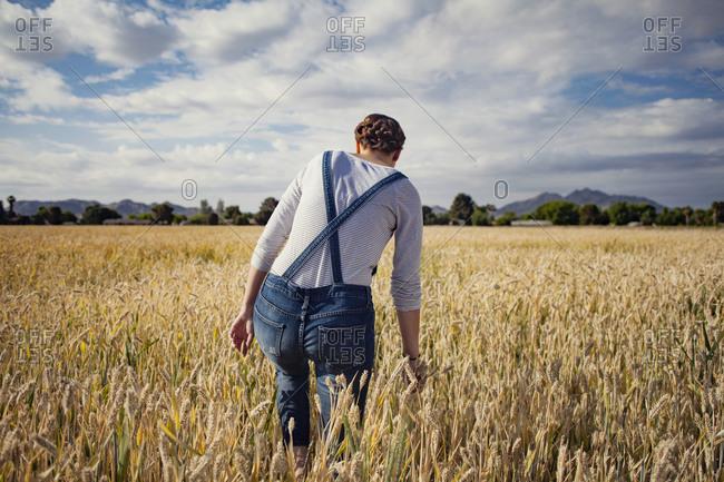 Woman walking in farm field