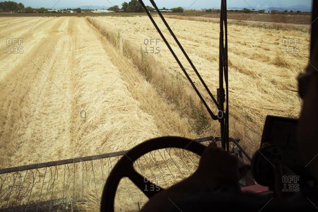 Driving a farm machine in field
