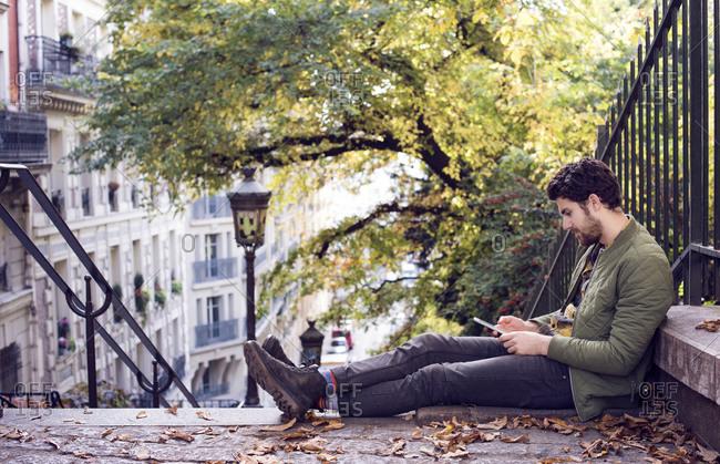 Man on phone on city steps