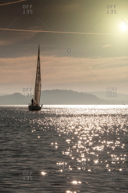 Boat on sparkling water surface, Lake Maggiore, Piedmont, Lombardy, Italy