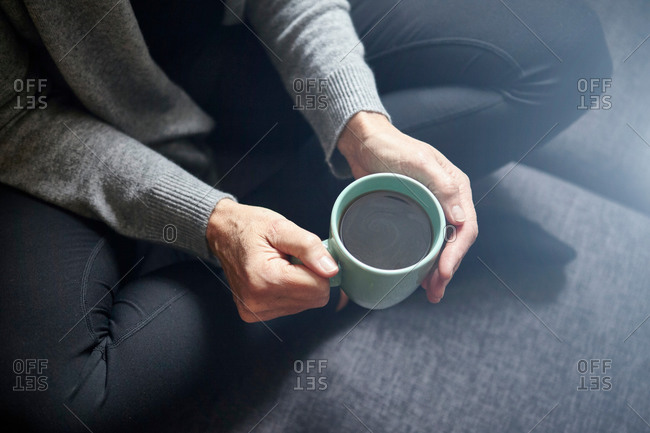 Woman having coffee - Offset Collection