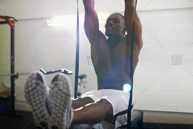 Bodybuilder working out in gym
