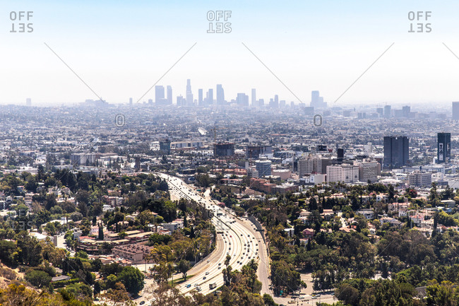Elevated view of highway curving through urban sprawl, Los Angeles, California, USA