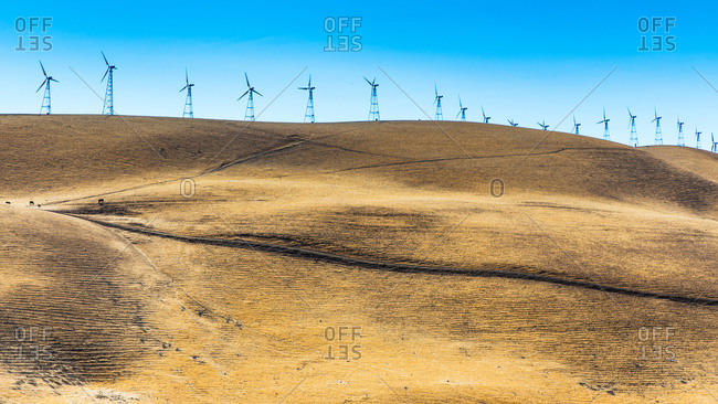 Low angle view of wind turbines on ridge, California, USA