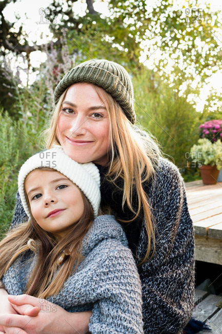 Mother and daughter wearing knitwear and hats, portrait