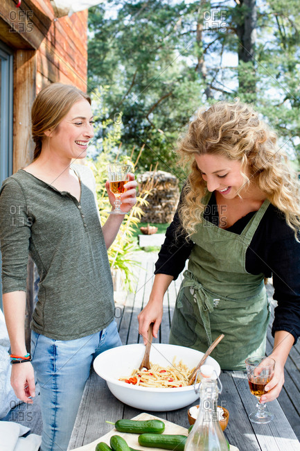 Two friends preparing lunch al fresco