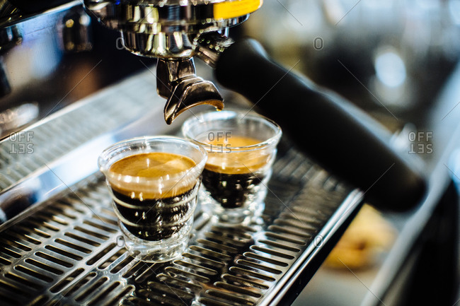 Two shot glasses of espresso on espresso machine