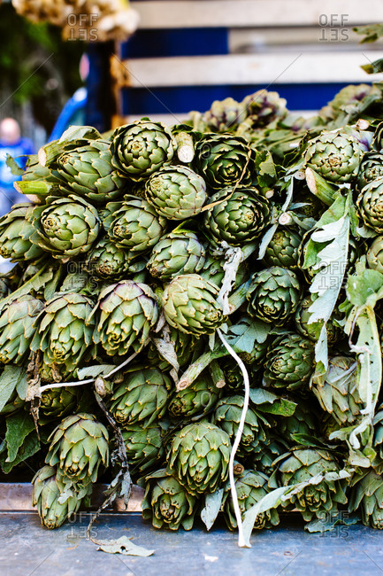 Stacked fresh artichokes in local market, Sicily, Italy