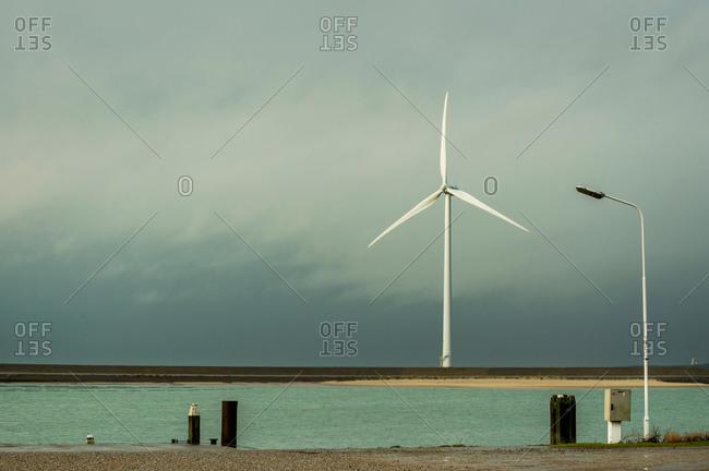 Wind turbine on dyke, Vrouwenpolder, Zeeland, The Netherlands