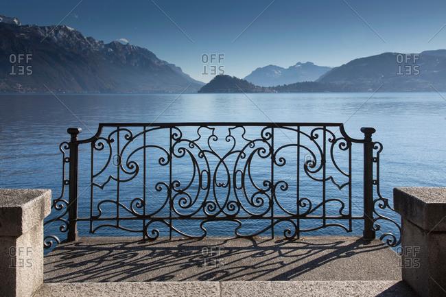 Ornate sunlit iron gate, Lake Como, Italy