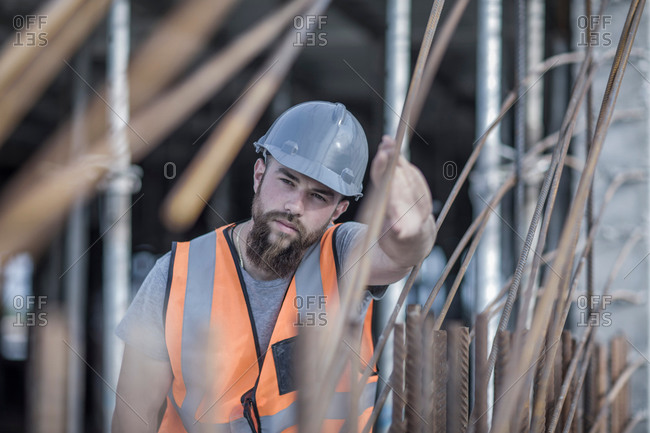 Site manager signaling with hand on construction site