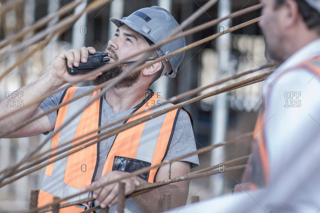 Site manager using walkie talkie on  construction site