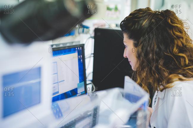 Female scientist using FTIR spectrophotometer, analyzing FTIR map