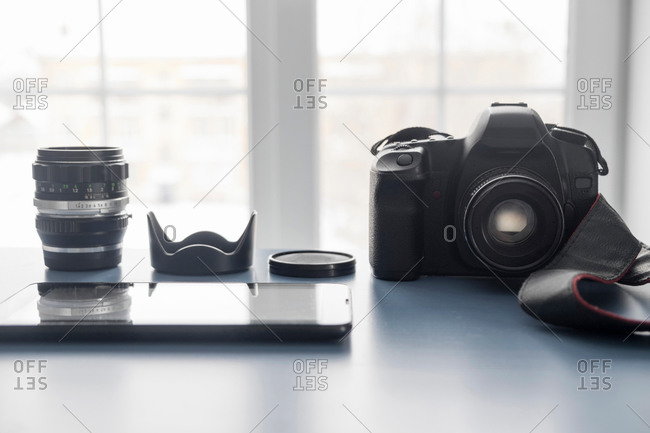 Digital tablet and digital SLR camera on studio desk