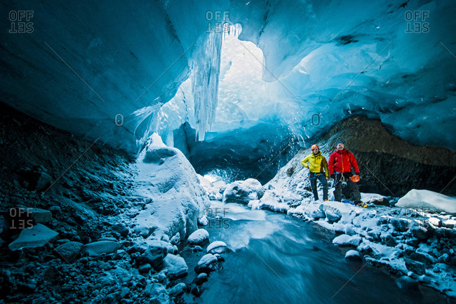 Portrait of two men in ice cave below the Gigjokull glacier, Thorsmork, Iceland