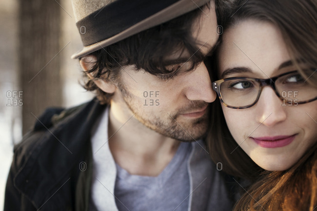 Portrait of a young couple standing close outdoors