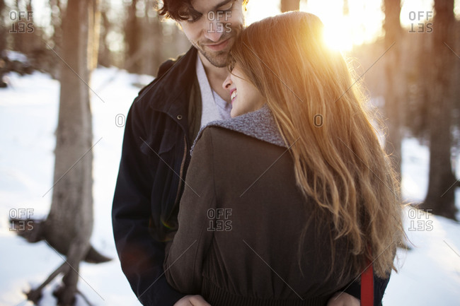 Portrait of a young couple hugging outdoors