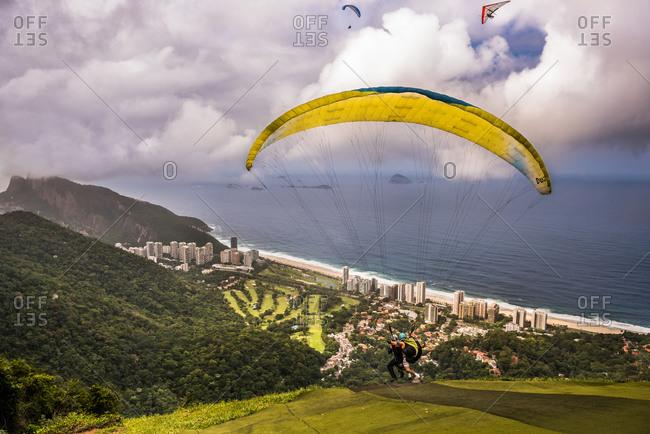 Paragliders take off above Rio de Janeiro