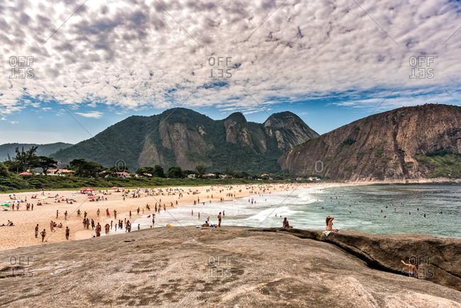 Beach goers at Itacoatiara Beach, Rio de Janerio
