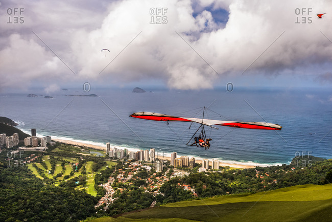 Hang gliders take off above Rio de Janeiro