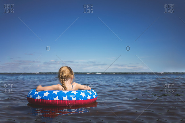Girl floating in a tube in calm water