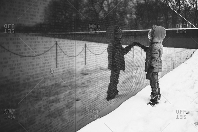 Young child visiting the Vietnam Memorial in Washington D.C.