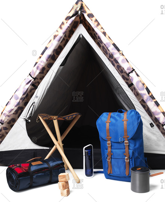 Camping gear in front of tent on white