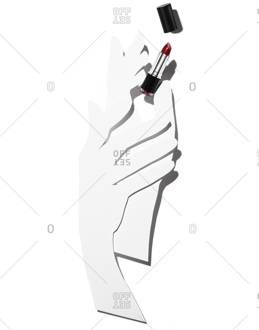 Paper hands holding tube of red lipstick