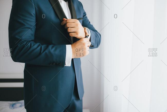 Man getting dressed in tuxedo