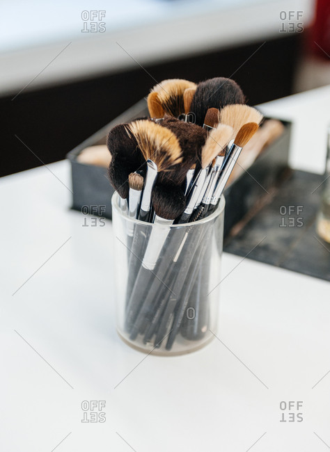 Makeup brushes in a jar