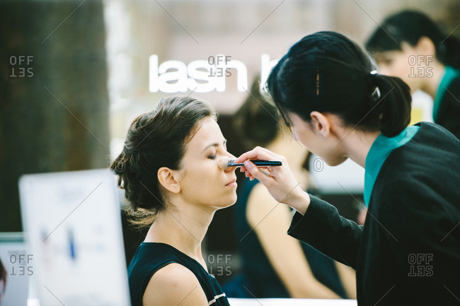 Strasbourg, France - August 30, 2014: Young woman having make-up done at beauty salon before her wedding