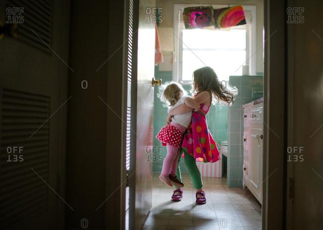 Sisters dancing in a bathroom