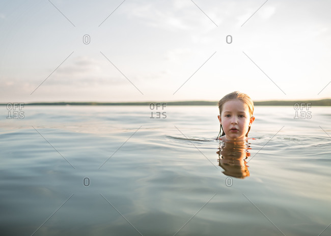A girl swimming in a lake