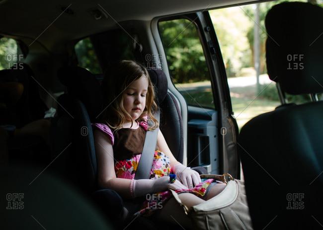 Girl buckled in van