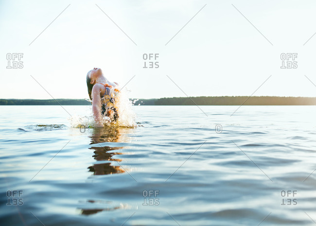 A girl jumping in a lake