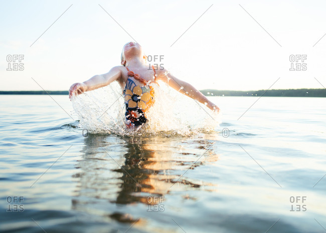 A girl splashing in lake