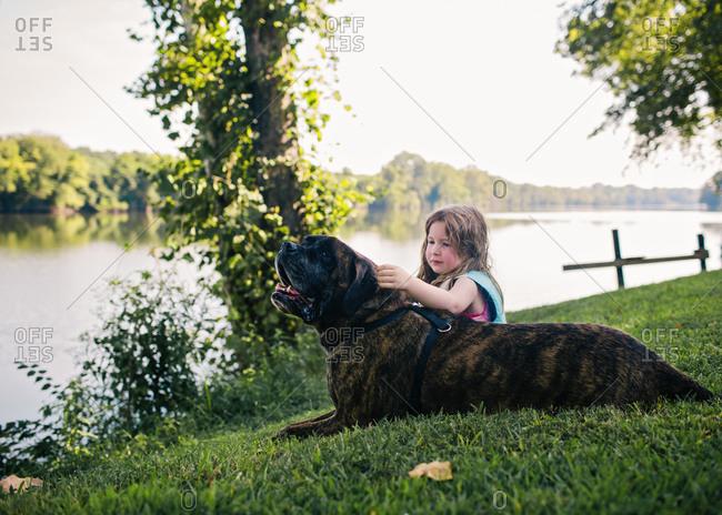 Girl petting her dog