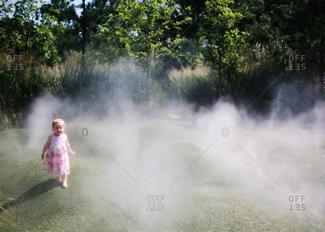 Toddler walking on grass