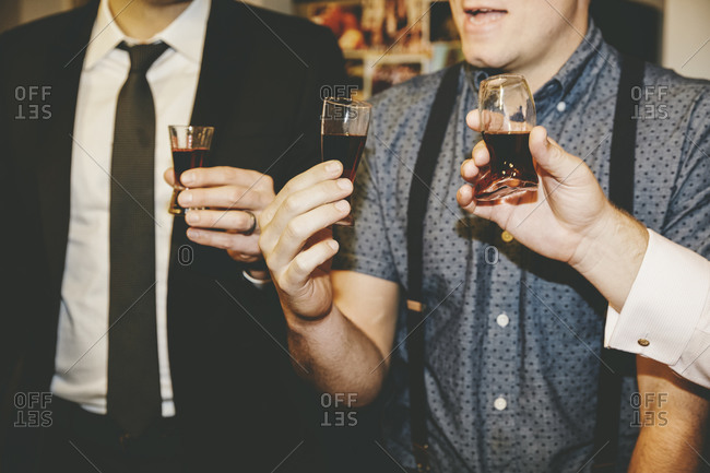 Friends at a party having a shot together