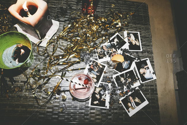 Instant pictures of a party on an outdoor table
