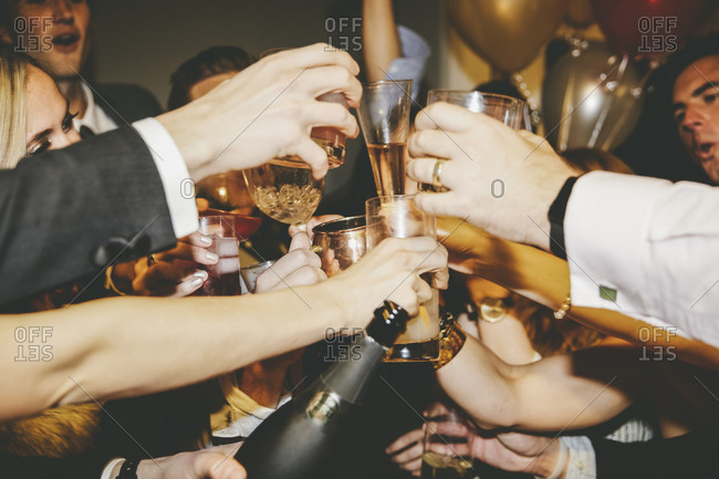 Friends at a party raising their glasses in a toast