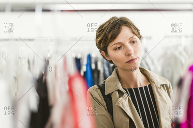 Woman shopping clothing racks