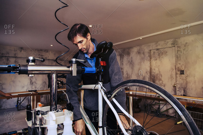 Man working on a bicycle in a repair shop